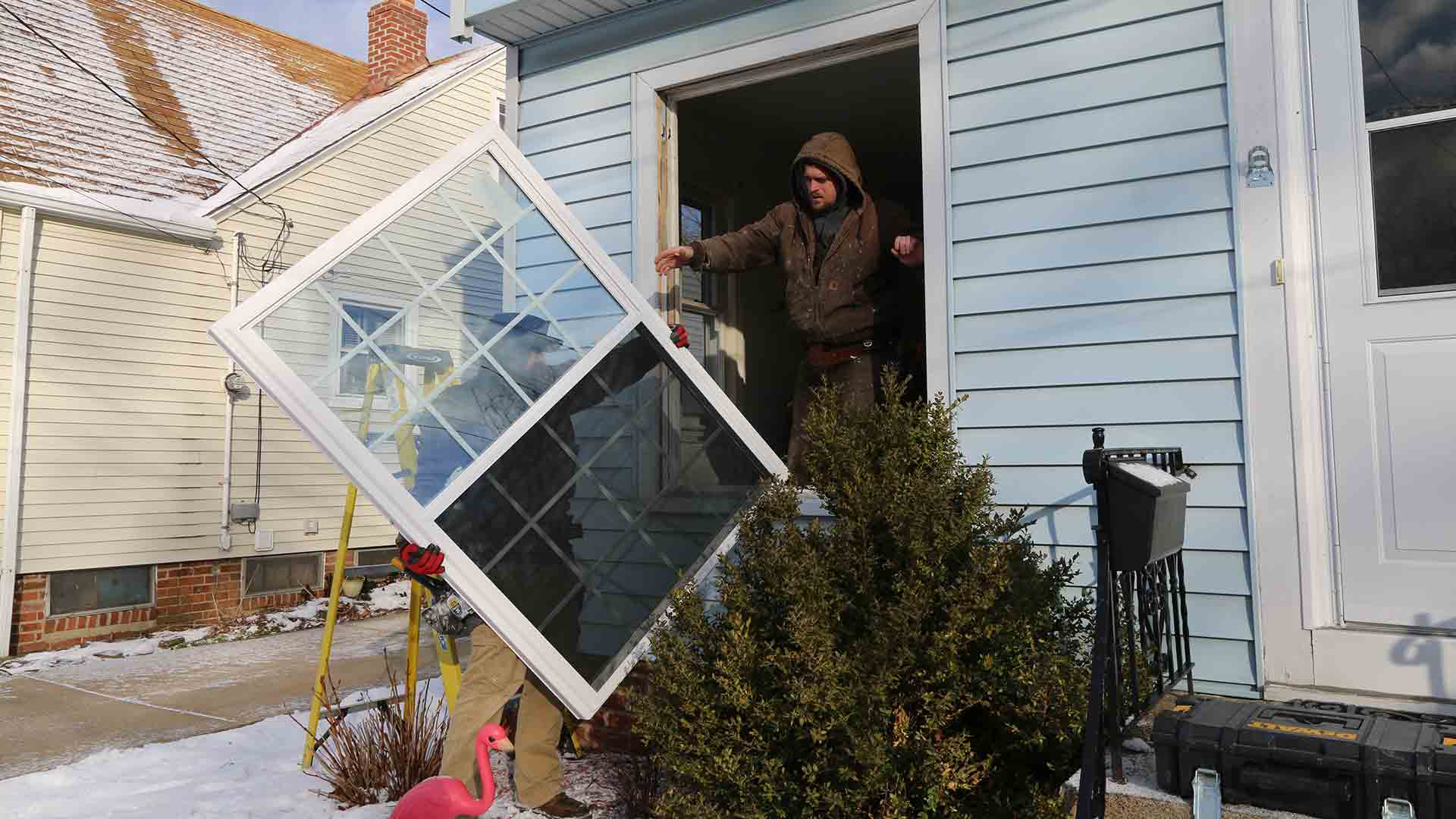 installers installing double hung window