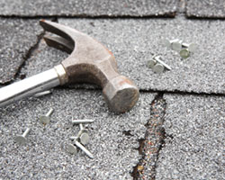 Broken shingles are one of the signs you need a new roof